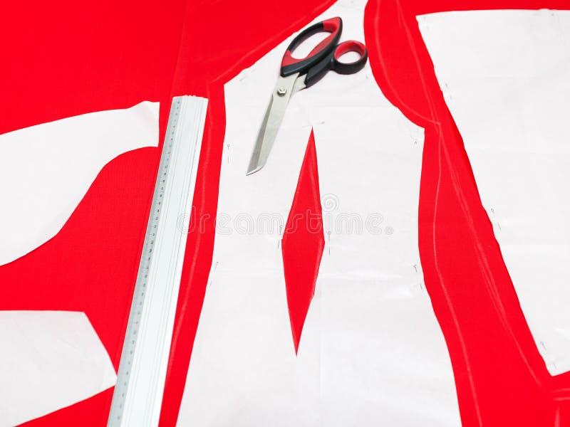 Ткань вырезывания для платьев стоковое изображение
