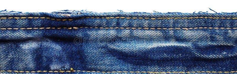 Ткань джинсов от брюк джинсов стоковое фото rf