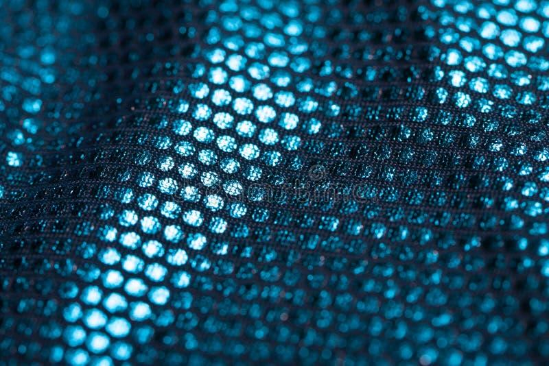 Ткань конца-вверх покрытый с отражательными точками которые дают изображению свой яркий блеск стоковые фотографии rf