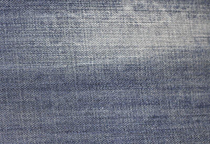 Ткань предпосылки текстуры джинсов голубой ткани джинсовой ткани стоковое изображение