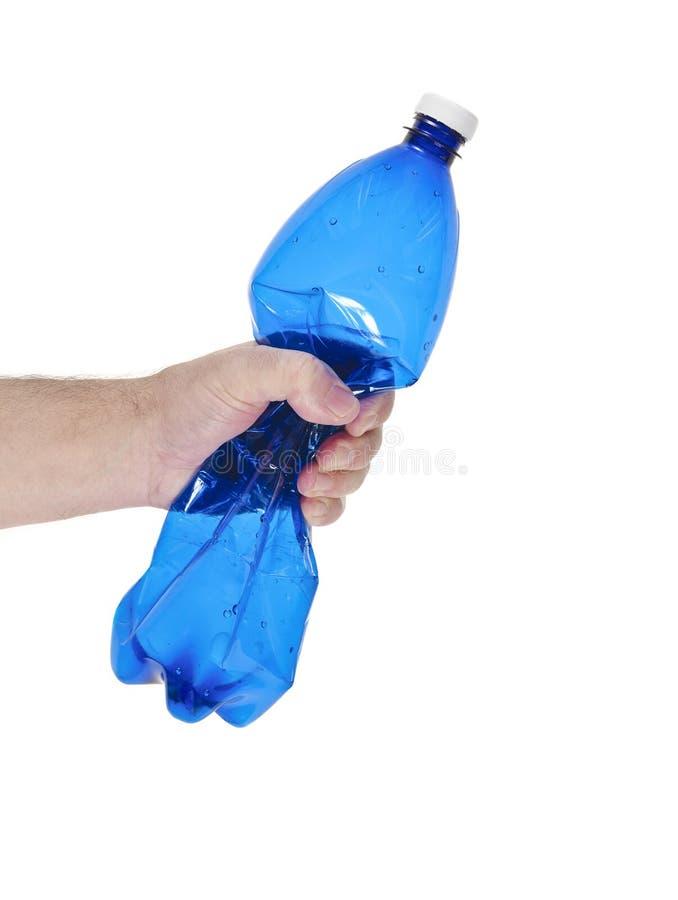 толкотня бутылки вручает пластмассу стоковые фотографии rf