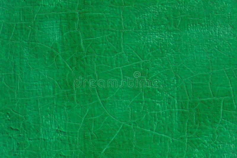 Толстая зеленая свежая краска масла на текстуре плоской стальной поверхности безшовной со старыми отказами под ей стоковое фото rf