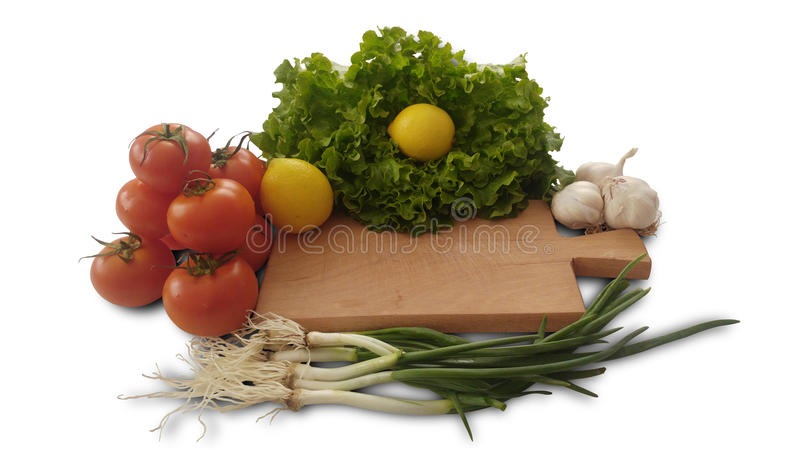 томаты, лимон, салат, чеснок и свежий лук салата стоковое фото
