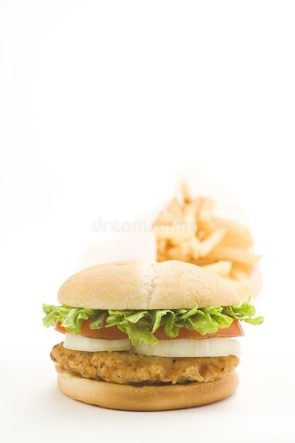 томат лука салата цыпленка сыра бургера хрустящий стоковые изображения rf