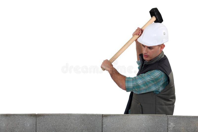 Топтащ используя мушкел стоковые изображения