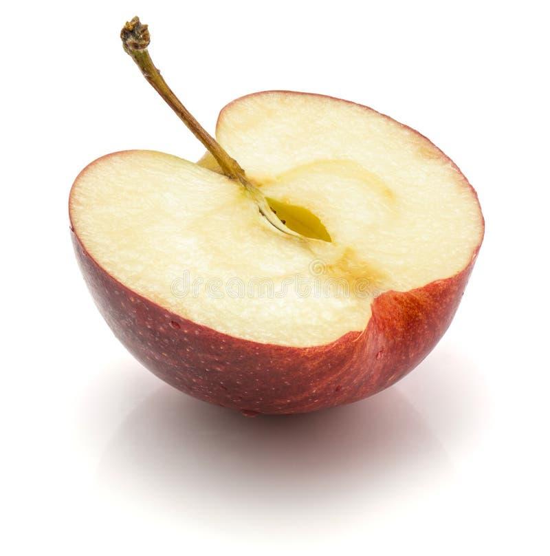 Торжественная половина яблока изолированная на белой предпосылке стоковая фотография