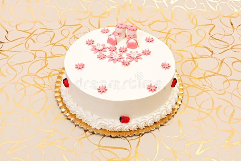 Торт баптиста для девушки стоковое фото rf