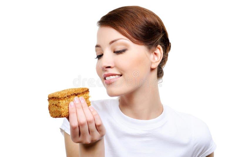 торт есть женщину стоковое фото