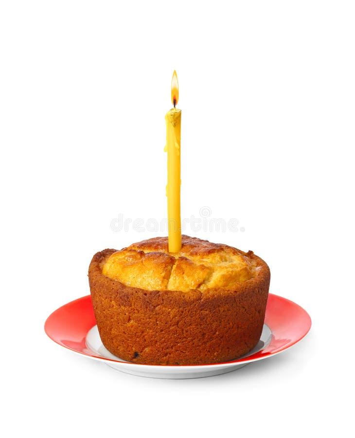 Торт и свеча горения стоковые изображения rf