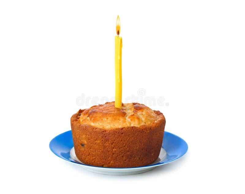 Торт и свеча горения стоковая фотография