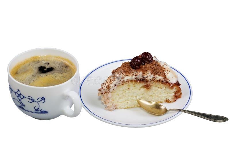 Торт на плите с чашкой кофе. стоковые изображения