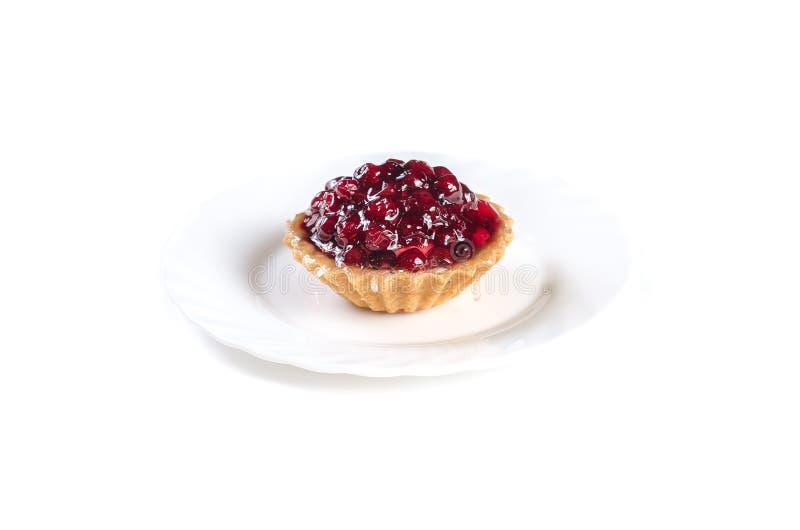 Торт студня Cowberry изолированный на белой предпосылке стоковая фотография rf
