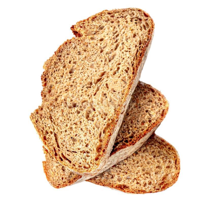 3 тоста хлеба изолированного на белой предпосылке Конец куска хлеба Брауна вверх Пекарня, концепция еды r стоковая фотография rf