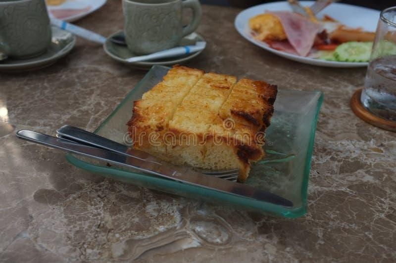 Тост меда на таблице стоковое изображение