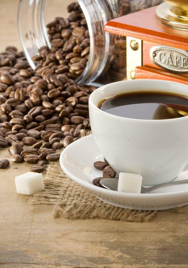 точильщик кофейной чашки стоковое изображение