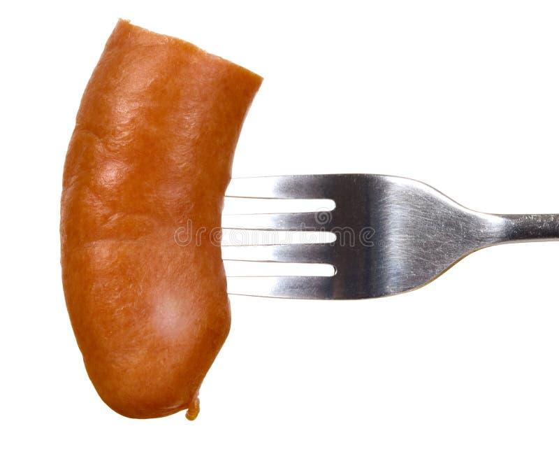 Толстая сосиска и вилка стоковые фото