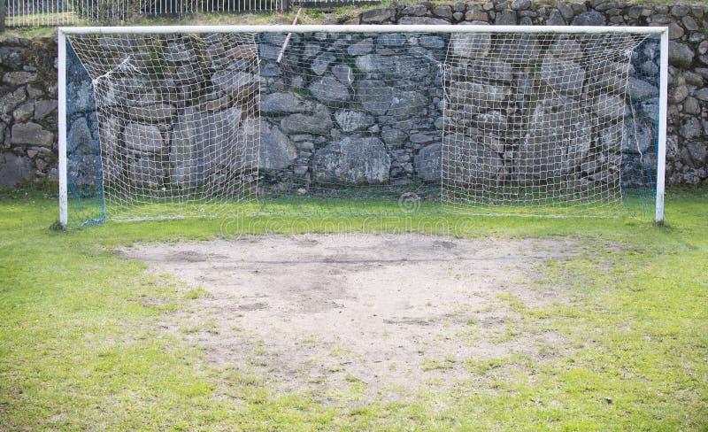 Трава сетчатого футбола цели футбола зеленая стоковое фото