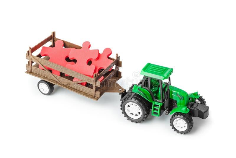 Трактор игрушки с головоломкой стоковые изображения