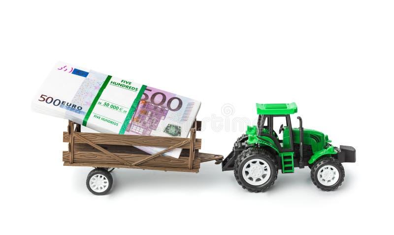 Трактор игрушки с деньгами стоковые изображения rf