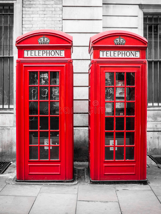 Традиционные красные переговорные будки в Лондоне, Англии стоковое фото