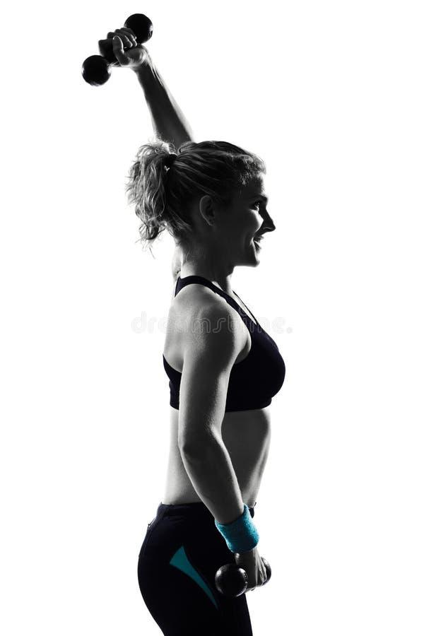 Тренировка веса позиции пригодности разминки женщины стоковое изображение rf