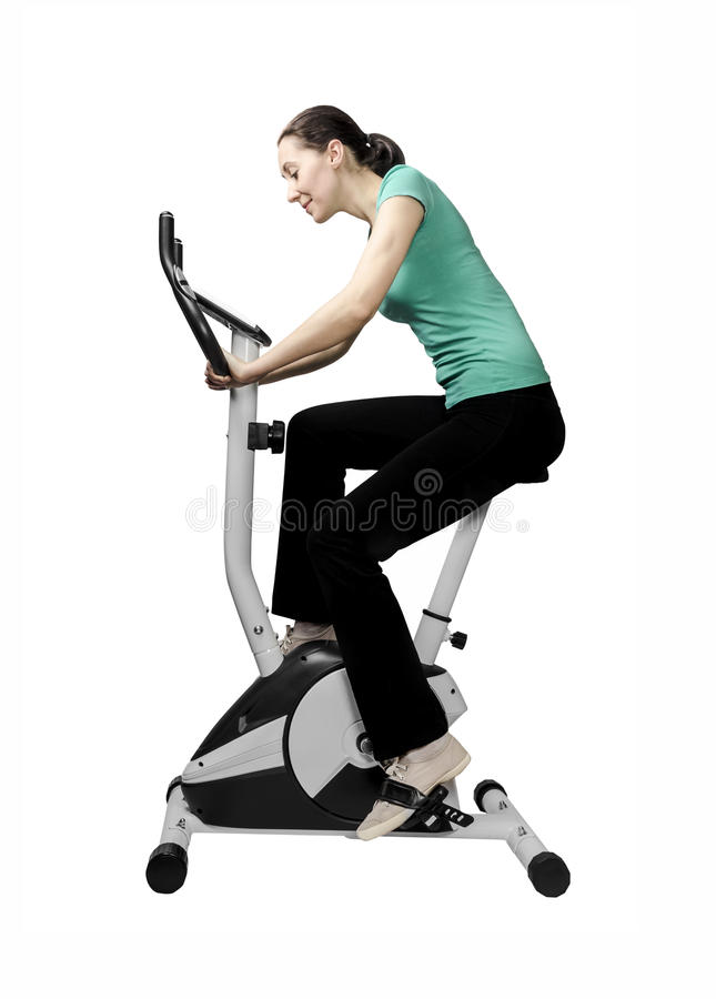 Тренировка на exerciser велосипеда стоковое фото