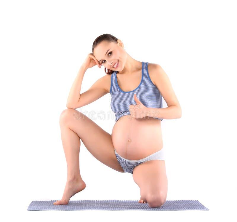 Тренировки женщины пренатальные стоковое изображение