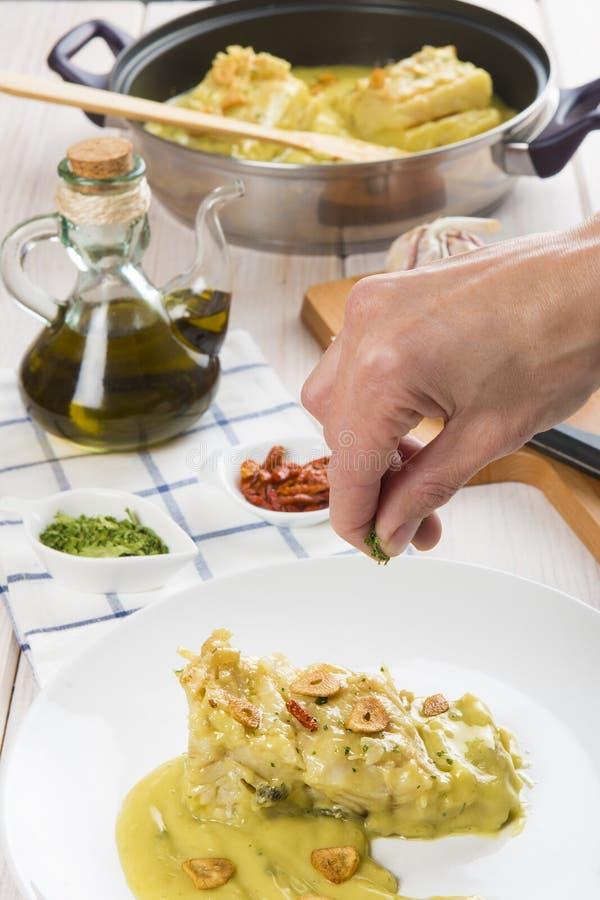 Треска соли в соусе pilpil стоковая фотография rf