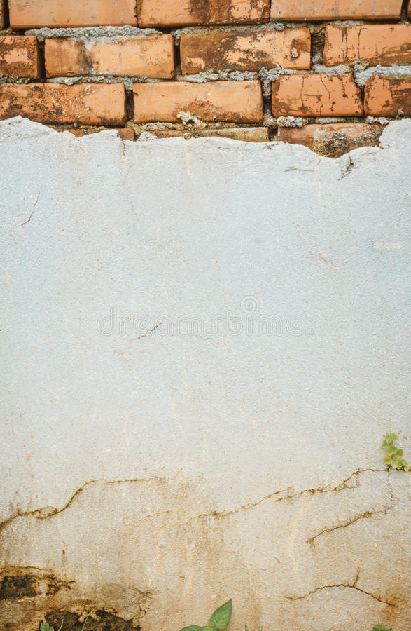 Треснутая конкретная кирпичная стена стоковое фото rf