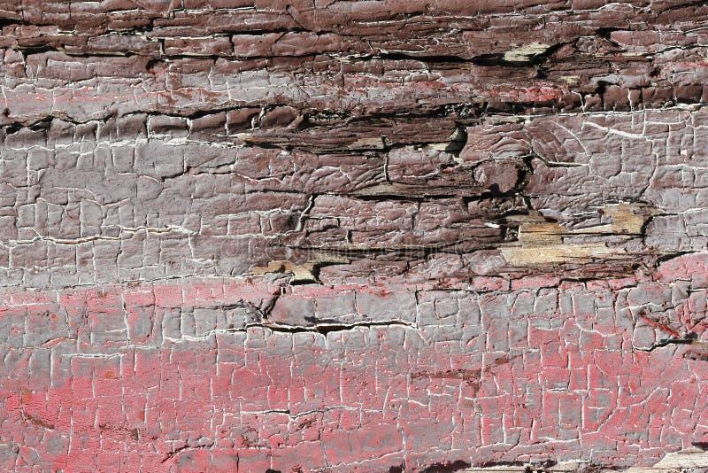 Треснутая краска на старой доске Справочная информация стоковые фото