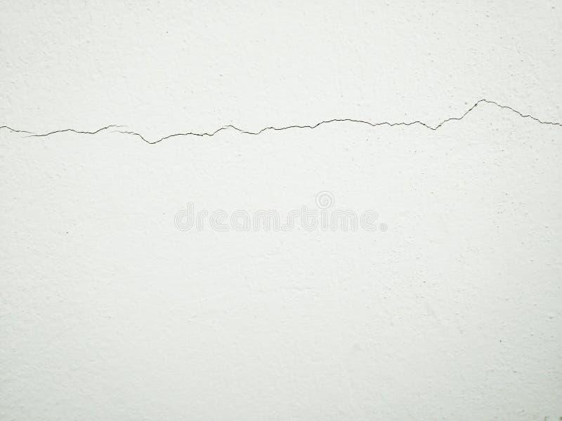 Треснутая предпосылка бетонной стены минимальная стена трещиноватости стоковые изображения