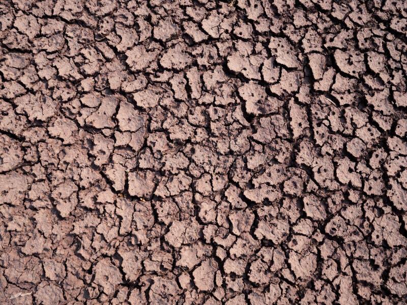 Треснутая текстура почвы grungy сухого треская влияния земли глобального проникая стоковое изображение rf