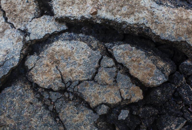 Треснутое clouse-up асфальта для предпосылки Грязная поверхность стоковая фотография rf