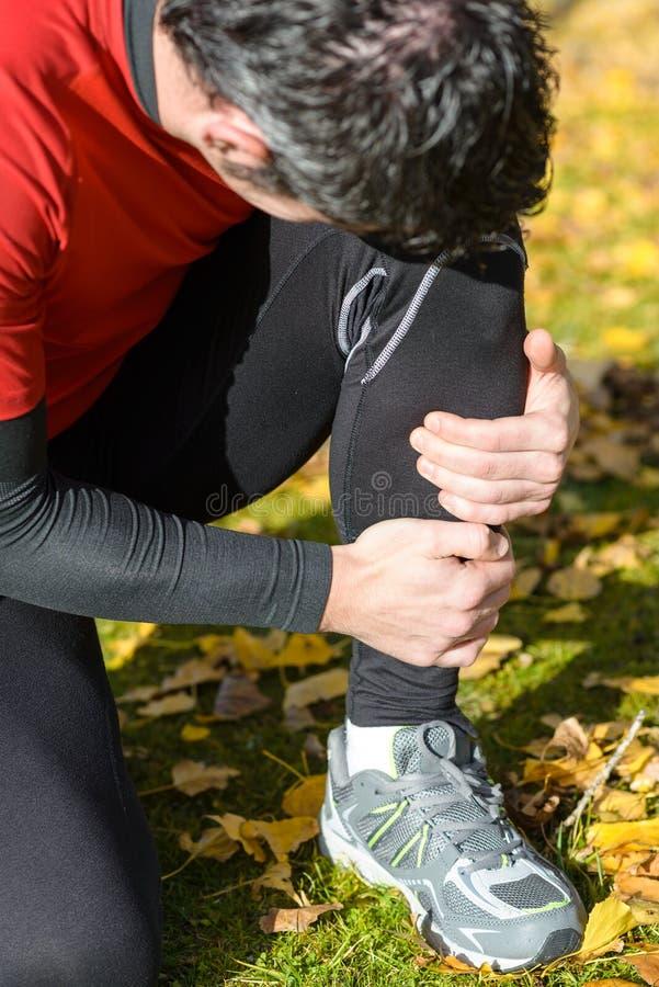 Трещиноватость ноги спортсмена стоковое фото rf
