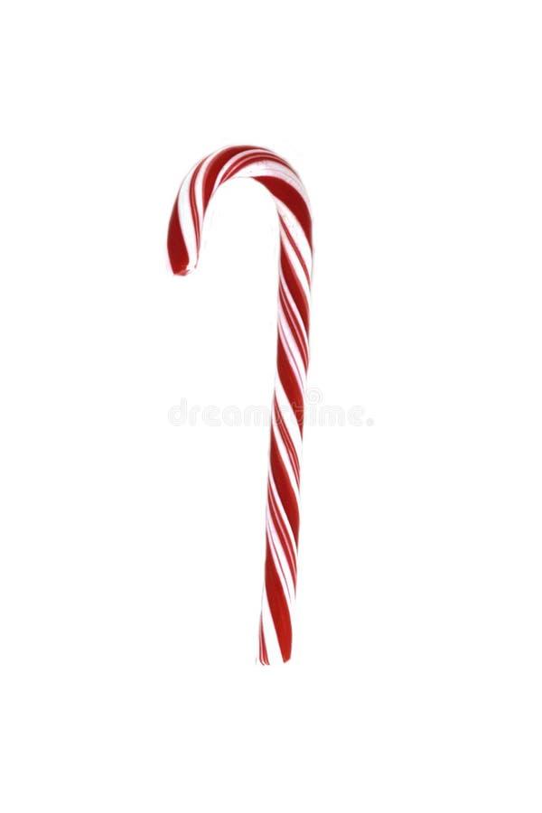 Тросточка конфеты рождества при красный смычок изолированный на белой предпосылке стоковое фото