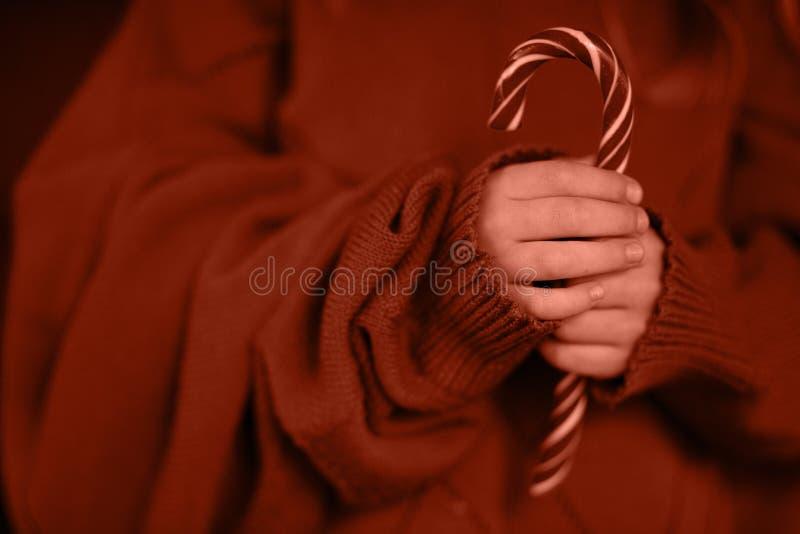 Тросточка ребенка и конфеты стоковые фото
