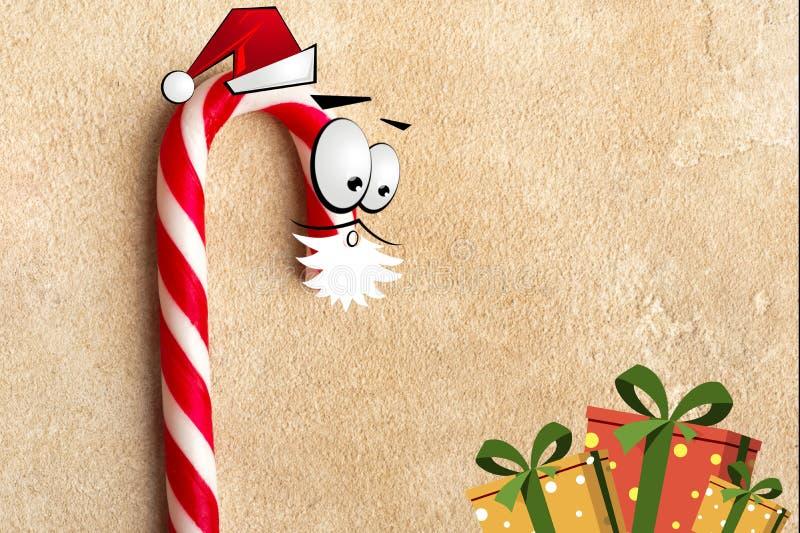 Тросточки конфеты рождества в одеждах Санта Клауса с подарками стоковые изображения rf