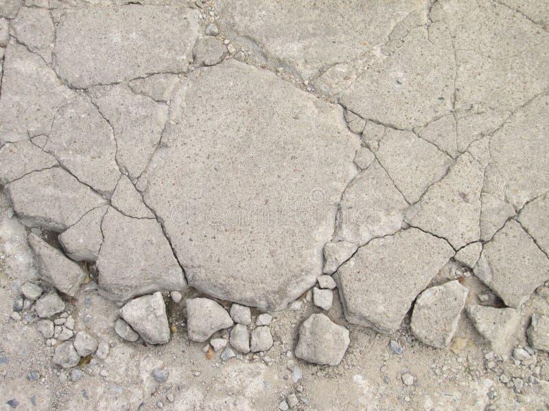 Тротуар текстурированный Grunge конкретный с отказами стоковое изображение