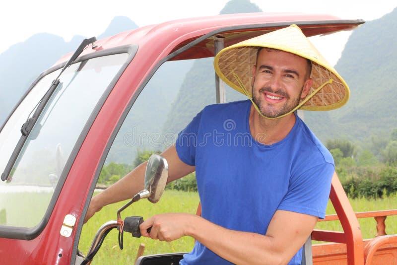 Туристский управляющ мото-такси в Азии стоковое фото rf