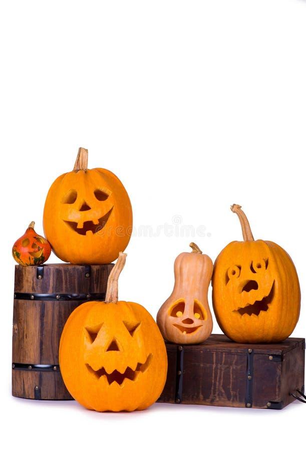 Тыква с подсвечником, смешная сторона хеллоуина стороны на белой предпосылке стоковые фото