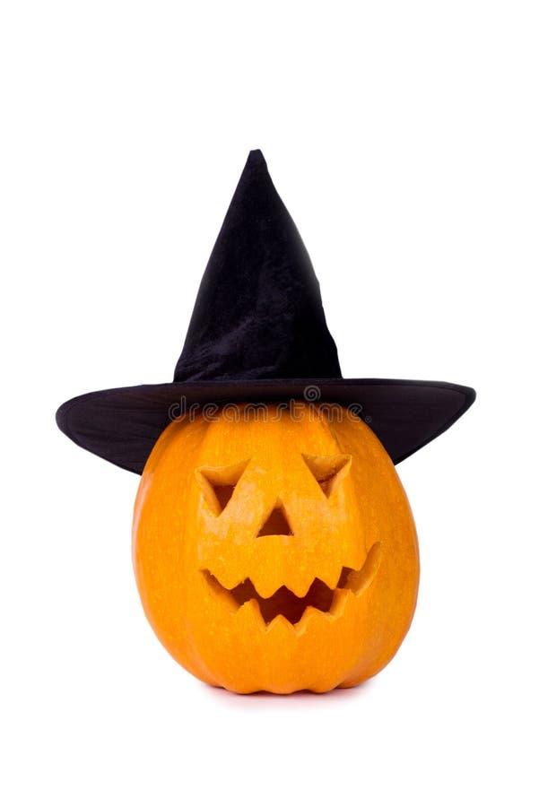 Тыква хеллоуина, смешная сторона в шляпе, изолированной на белой предпосылке стоковое фото