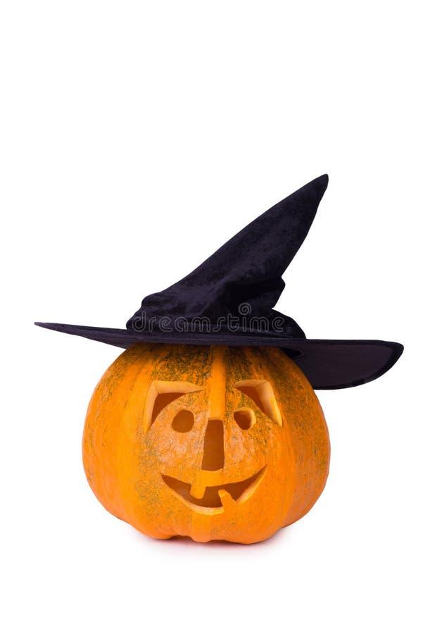 Тыква хеллоуина, смешная сторона в шляпе, на белой предпосылке стоковое фото rf