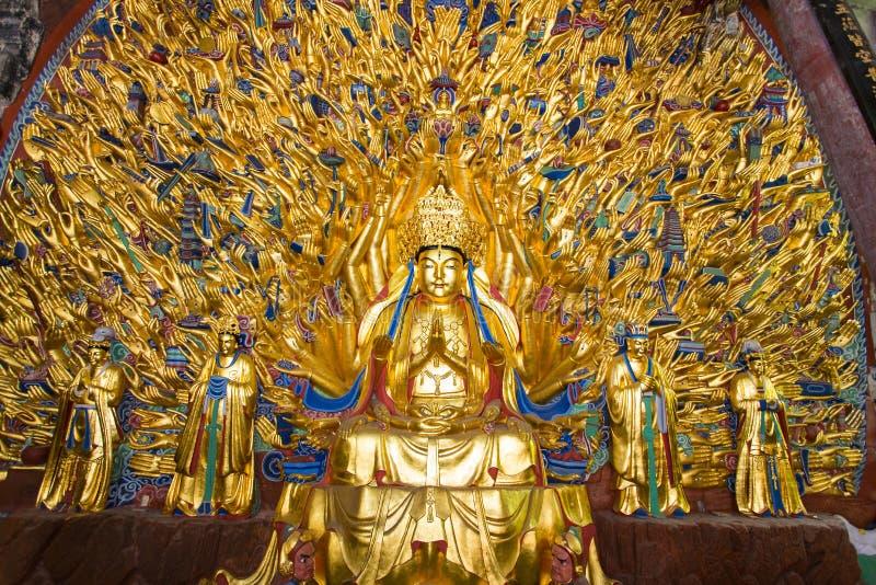 Тысяча статуй Будды рук на звоне Bao на резном изображении утеса Dazu стоковые изображения rf