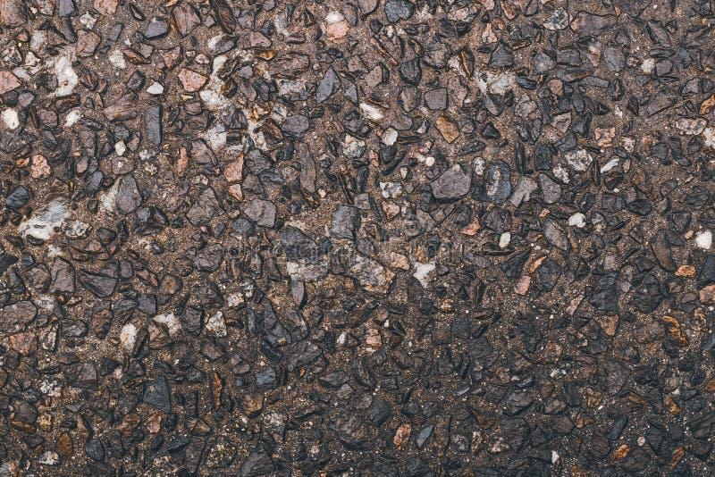 Тяжёлая текстура камня, гравия Поверхность решетки Фоновый фон коричневого камня Маленькие гальки на полу, природная каменная сте стоковое фото
