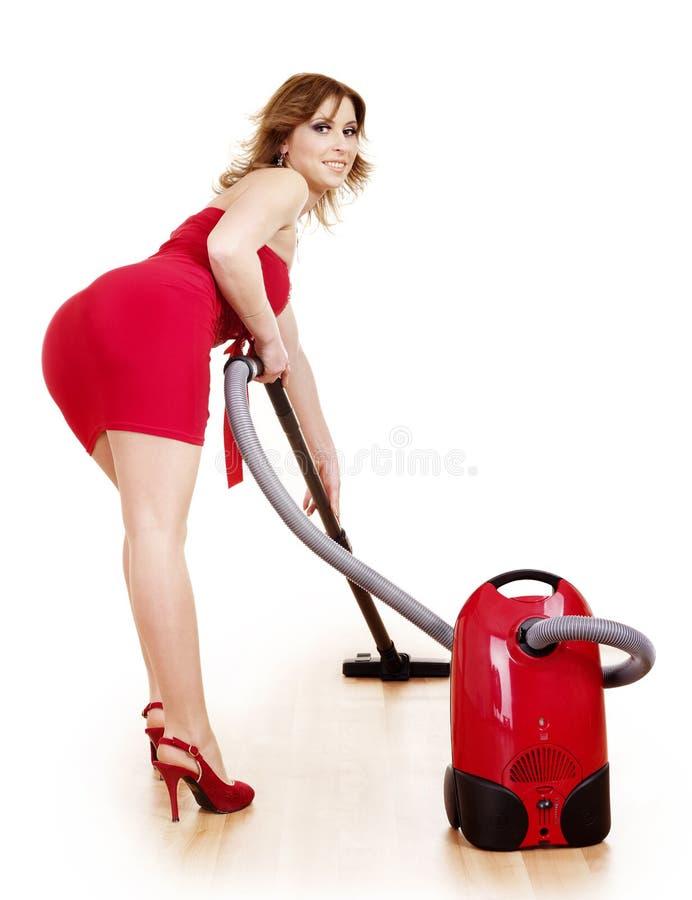 уборщик используя детенышей женщины вакуума стоковое фото