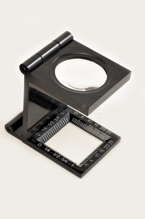 увеличивать изолированный стеклом стоковая фотография