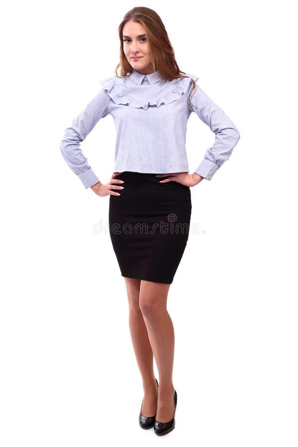 Уверенно молодая женщина изолированная на белизне стоковые изображения rf