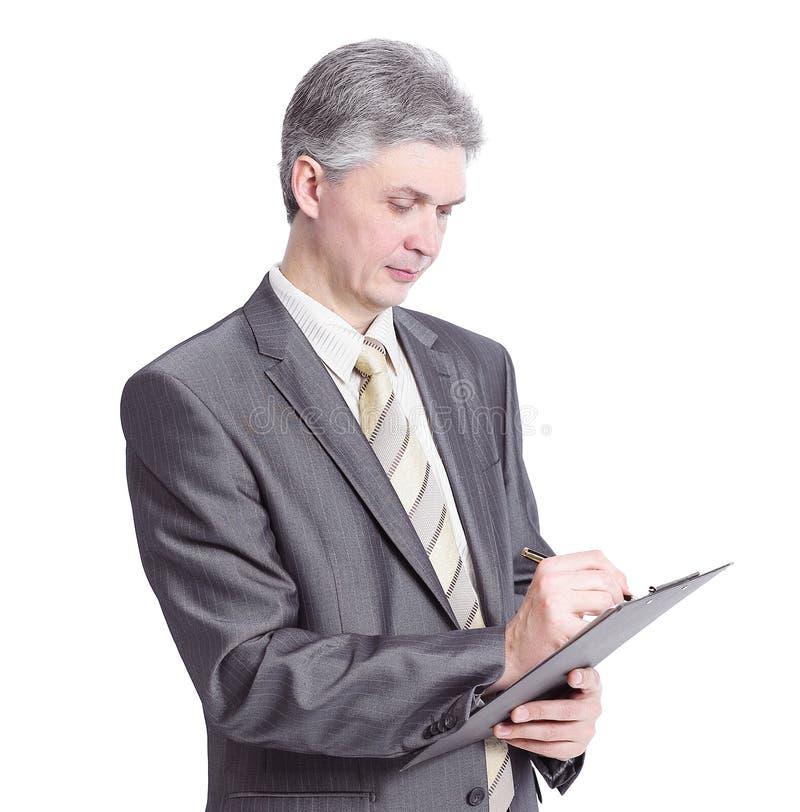 Уверенно сочинительство бизнесмена в книге назначения стоковое фото rf