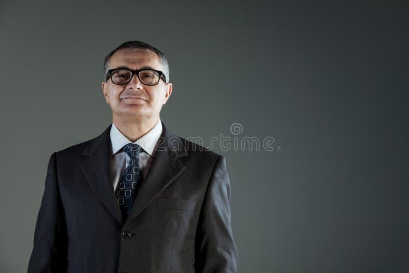 Уверенно средн-постаретый руководитель бизнеса стоковая фотография
