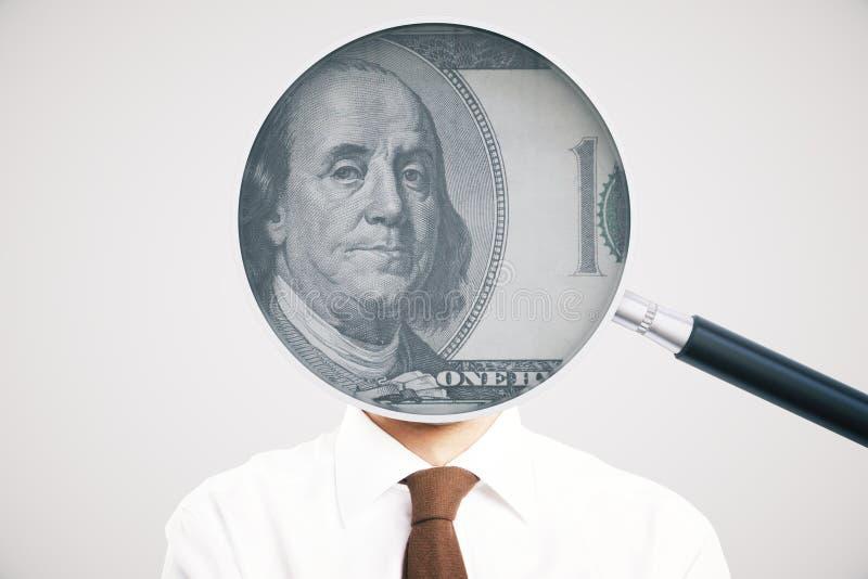 Увеличитель с долларом на человеке стоковая фотография